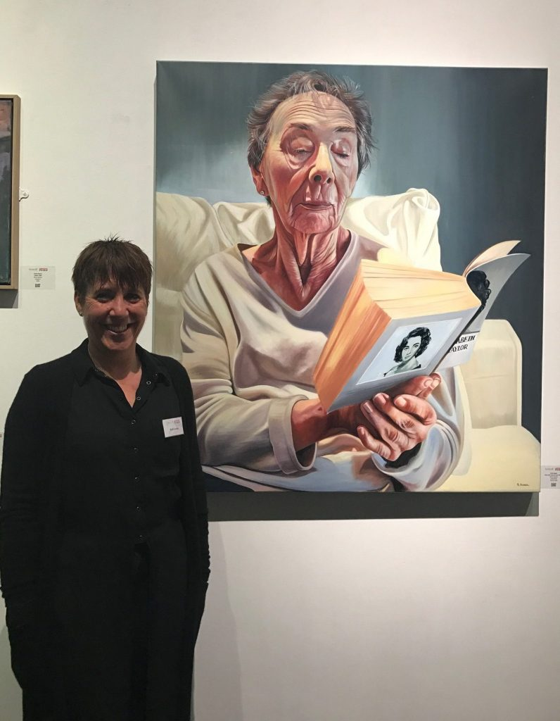 Ruth next to winning painting in the Mall Gallery.